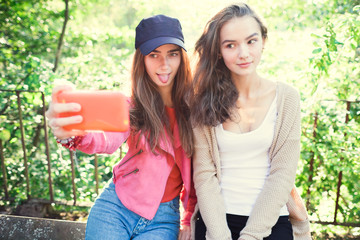 two beautiful girl photographed themselves on the phone