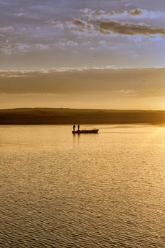 Traditional fishing boat at sunset in Suez canal, Egypt