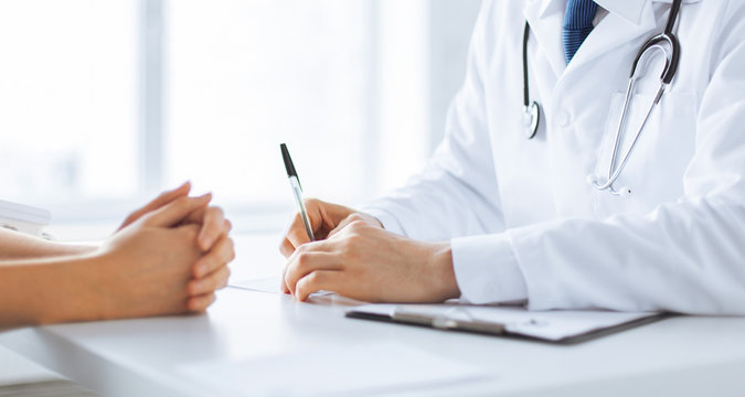patient and doctor taking notes
