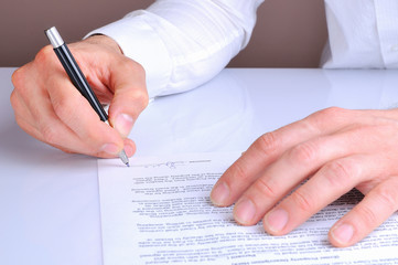 Client signing the mortgage loan agreement rear view
