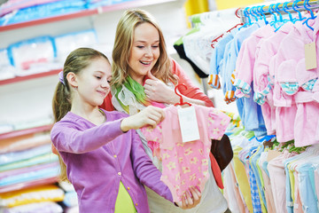 woman and girl shopping clothes