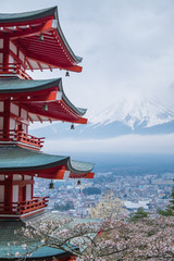 Foto op Canvas Kersenbloesem Chureito Pagoda with mount Fuji background in cloudy day