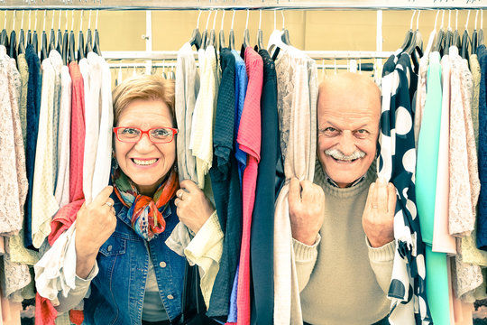 Playful senior couple at weakly flea market - Happy elderly