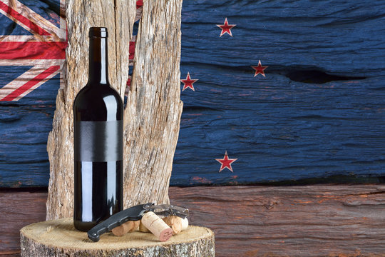 bottle of wine with New Zealand flag in the background
