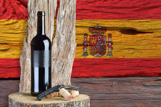 bottle of wine with Spain flag in the background