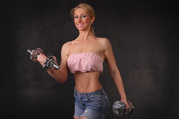 Athletic  woman doing workout with weights
