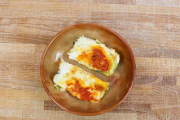 italian lasagna with tomato inside ceramic bowl