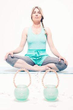 Young woman sitting cross-legged practicing yoga