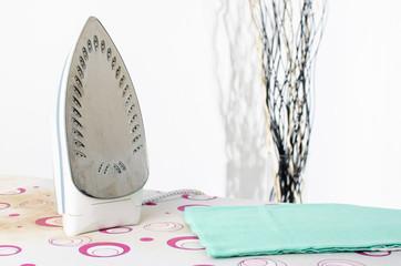 Iron on an ironing board