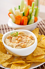Healthy homemade hummus with vegetables, olive oil and pita chip