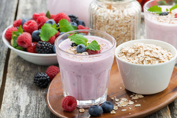 berry smoothie with oatmeal in a glass on wooden table