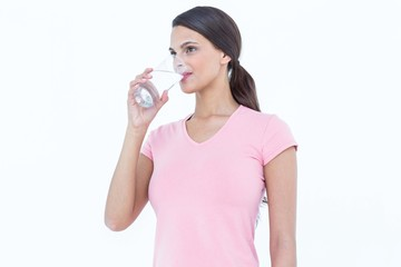 Pretty woman drinking glass of water