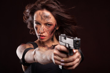 Sexy Military Girl with gun. Blood drop on face