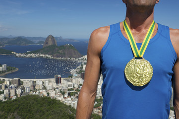 Gold Medal Athlete Standing Rio Skyline