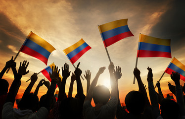 Silhouettes People Holding Flag Colombia Concept