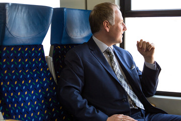 Businessman sitting in a train