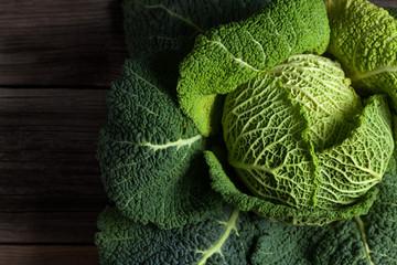 Savoy cabbage super food on dark wooden background