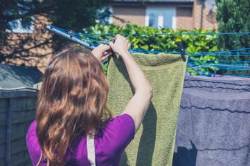 Woman hanging her laundry in garden