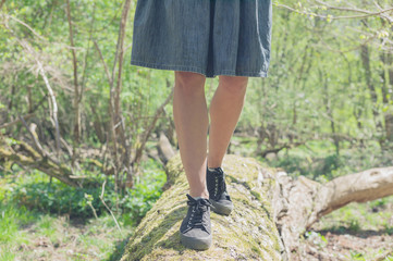 Woman walking on a felled tree