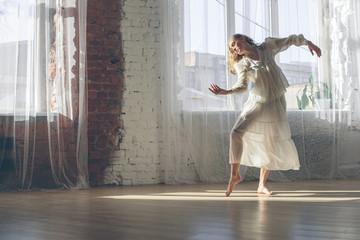 Beautiful yang woman listening to music and dancing