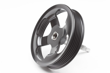 Black pulley car engine on a gray background