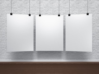 white posters on brik wall