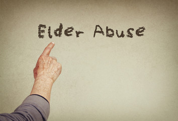 senior man hand pointing at text  phrase elder abuse
