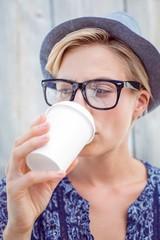 Pretty blonde woman drinking coffee