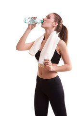 Woman after sport drinking water from bottle