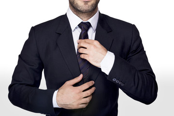 Businessman adjusting a tie