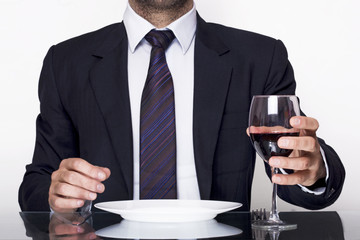 Business dining and holding a glass of wine