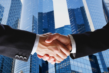 business deal, handshake on modern blue background