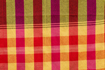 Fabric background cells of red,orange and yellow