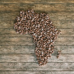Map of Africa made of roasted coffee beans on wooden background
