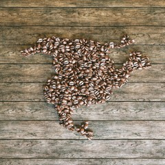 Map of North America made of coffee beans on vintage wooden