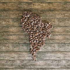 Map of South America made of roasted coffee beans on wooden