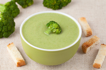 Organic green broccoli soup vegan recipe with croutons