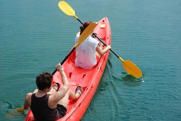 Travelar paddle a kayak on the sea. Kayaking on island