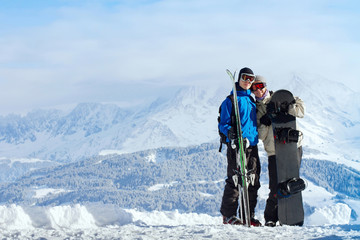 happy young couple at ski vacations