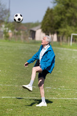Old man playing football