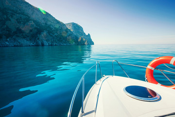 Private boat near mountains. Luxury Lifestyle. Traveling yacht