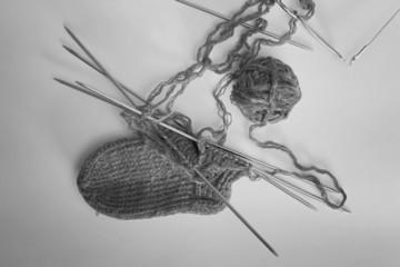 skein of yarn to knit socks spokes monochrome