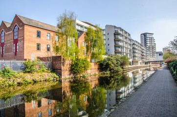 View of canal in Nottingham city centre with old and new buildings
