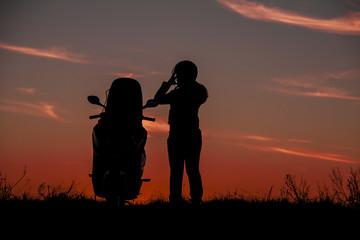 Silhouette motorbike and biker women