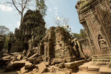 Ta Prohm ruins with carved apsaras and tower