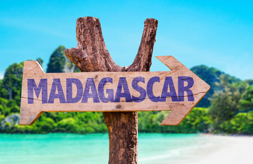Madagascar wooden sign with beach background