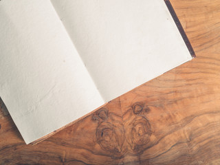 Open notepad on a wooden table