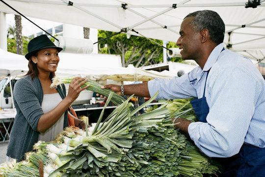 Black woman shopping at outdoor market