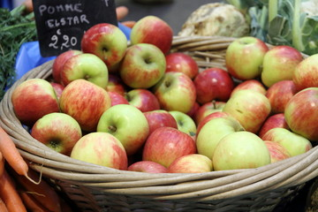 Basket filled with bright red and green apples., Provins, France