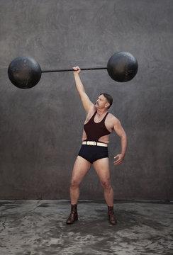 Caucasian weight lifter holding weights